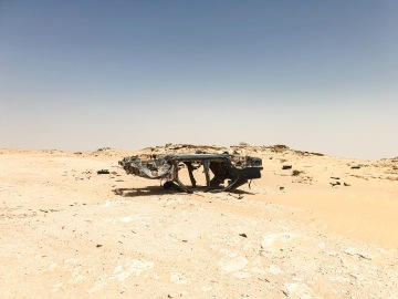 Remains of a car stuck in the no man's land.