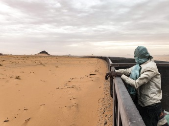 Inside the longest train in the world : 2km length. It carries iron ore, and passengers can climb inside the mineral wagons for free, for a shaking and dusty 9hours overnight ride. Between Nouadhibou and Choum, Mauritania.