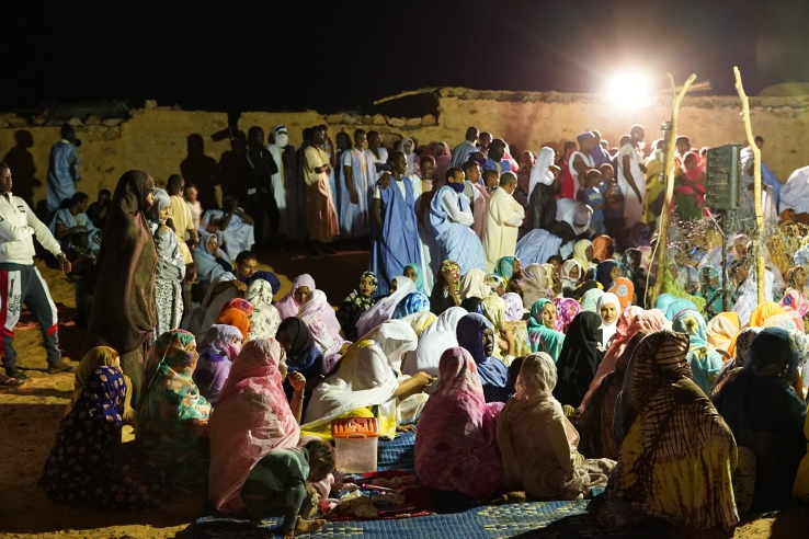 Men and women gathering at a traditional wedding. Chinguetti, Mauritania.